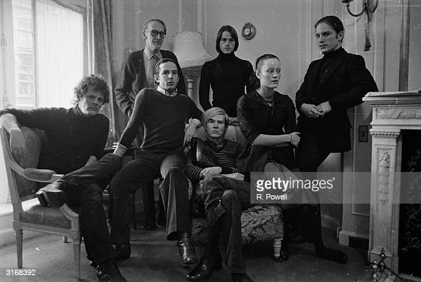 Pop artist Andy Warhol at the Ritz Hotel in London to promote the film 'Trash', directed by Paul Morrissey and produced by himself. With him are...