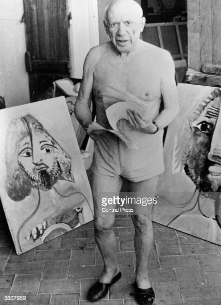 Spanish artist Pablo Picasso with some of his paintings at Mougins Cote D'Azur in the south of France