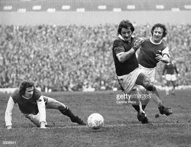 Arsenal's Liam Brady watches unable to reach the ball as team mate George Armstrong races after Leicester City's Frank Worthington during their FA...