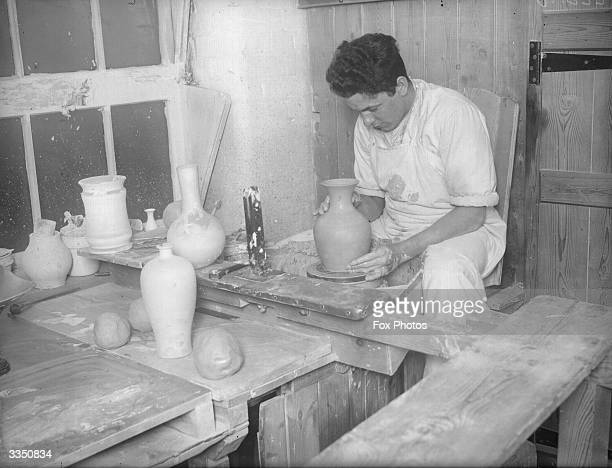 A potter at work at the Wedgwood pottery Stoke On Trent Staffordshire