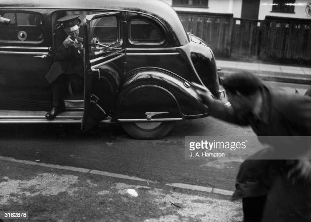 A policeman from Scotland Yard puts a new crime fighting invention the bullet proof car to the test in a mock shootout with a fake gangster