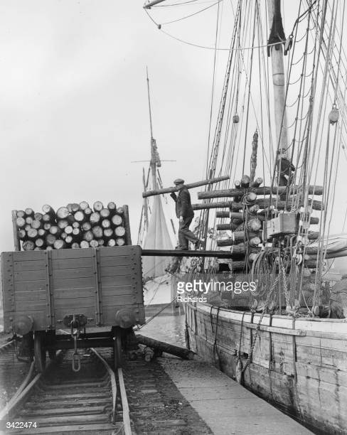 French sailing ship unloading pit-props in Cardif Docks.