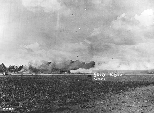 Airforce hangar burns after a Japanese attack the strategic Henderson Airfield at Guadalcanal.