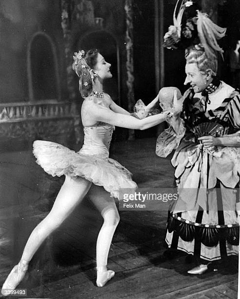 Moira Shearer as Cinderella with Ugly Sister Robert Helpmann in a production of the ballet 'Cinderella' choreographed by Frederick Ashton at Covent...