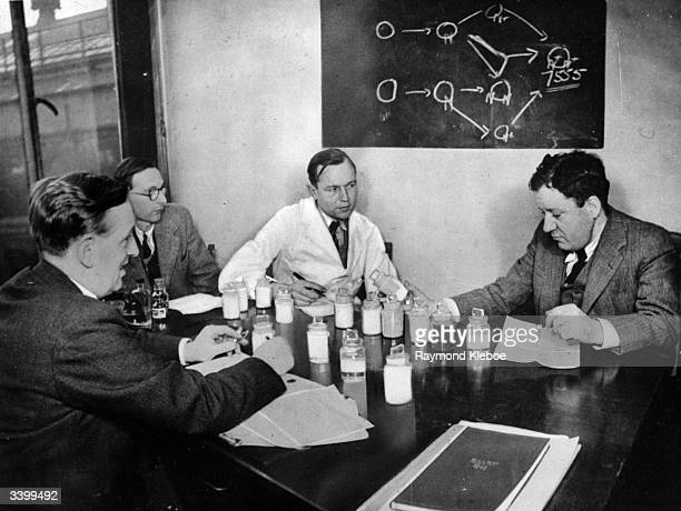 Scientists working for ICI discussing the new anti tsetse chemical Antrycide and methods to speed up its production. Original Publication: Picture...