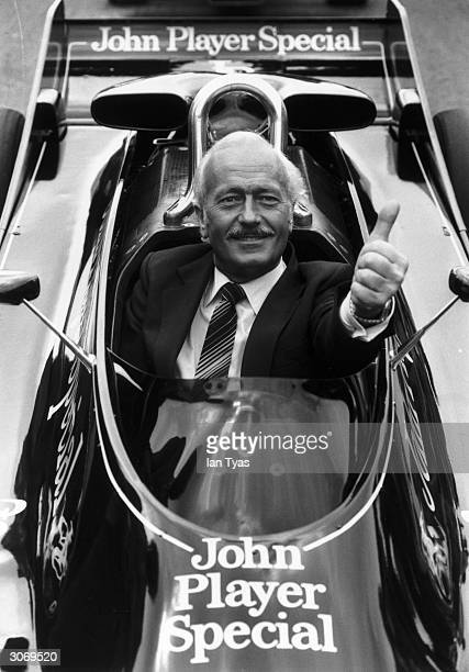 British racing car developer and builder Colin Chapman in a lotus John Player Special type 87 at Brands Hatch