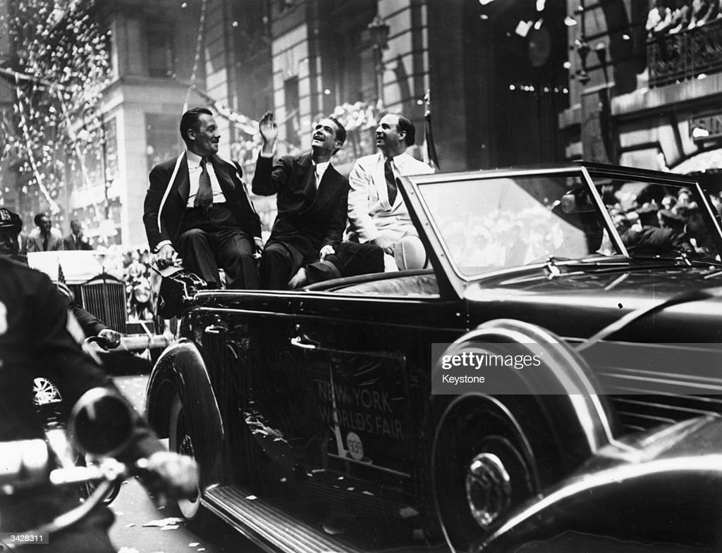 American filmmaker, aviator and multi-millionaire Howard Hughes (1905 - 1976) waving to the New York crowd during a ticker tape parade following his breaking of the world air speed record.