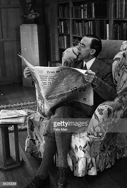 Labour politician Sir Stafford Cripps reading a newspaper at his home in the Cotswolds Original Publication Picture Post 178 At Home Sir Stafford...