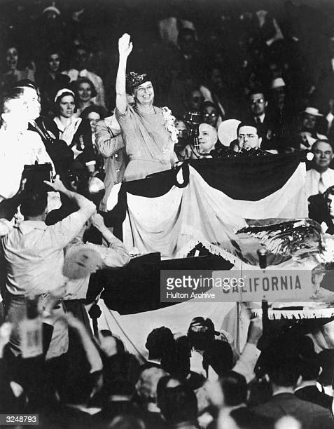 First Lady Eleanor Roosevelt waves to the crowd from the podium at the Democratic National Convention Chicago Illinois