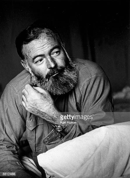 American writer and war correspondent Ernest Hemingway . Original Publication: Picture Post - 1748 - Hemingway Looks At The War In Europe - pub. 1944