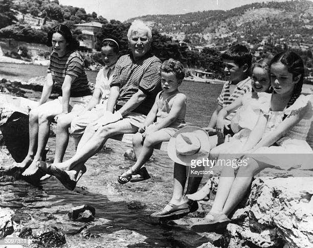 British born film actor director and producer Charlie Chaplin on holiday in Saint Cap Ferrat with his family his wife Oona and their children...
