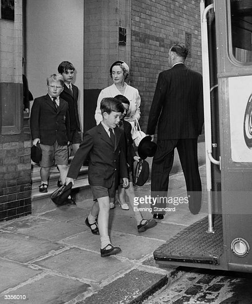Prince Charles boarding a bus en route to his school sports day
