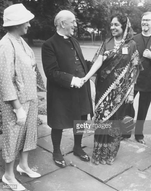 Archbishop of Canterbury Geoffrey Francis Fisher Baron Fisher of Lambeth receiving the sister of Bishop De Mel of Ceylon in the garden of Lambeth...