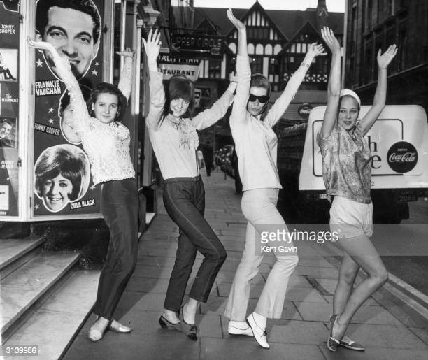 British actress Millicent Martin singer Cilla Black Susan Hampshire and Sylvia Syms rehearsing their chorus girl act for the charity 'Night of 100...