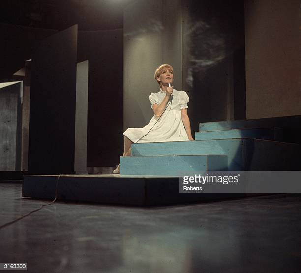 English pop singer actress and former child star Petula Clark singing in a television studio