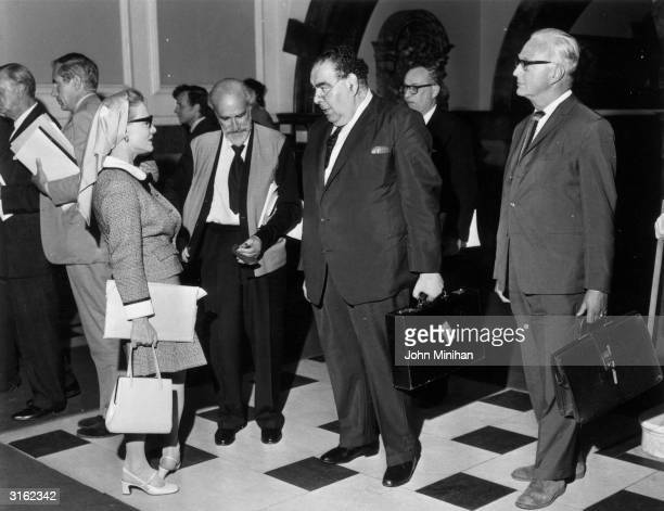 American actress Constance Cummings with husband Ben Levy and newspaperman Lord Goodman at the Wigmore Hall in London
