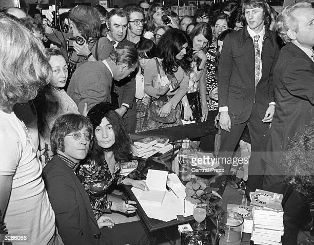 Ex-Beatle John Lennon with his wife Yoko Ono at Selfridges in Oxford Street, London, where Yoko was signing copies of her new book 'Grapefruit'.