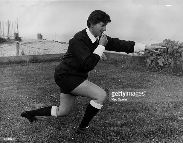 In referee's pose Mrs Terry Clark of Pevensey Bay Sussex who passed the Football Associations's exam to become the first woman football referee in...