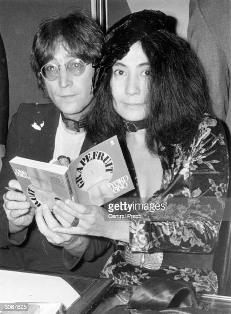 John Lennon with his wife Yoko Ono at a book signing session in Selfridges department store in London