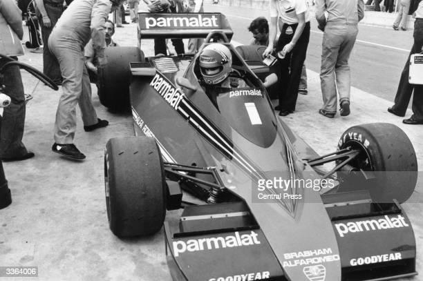 Motor racing driver and champion Niki Lauda in his F1 Brabham Alfa Romeo of the Parmalat racing team at practice for the British Grand Prix at...