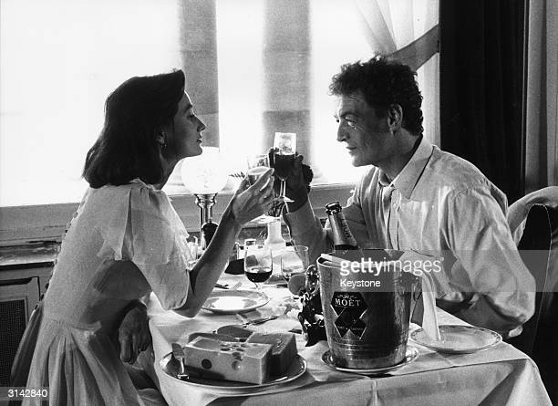 French actors Evelyne Bouix and Philippe Leotard during a scene from the film 'Ni Avec Toi Ni Sans Toi' being shot at the Grand Hotel Des Thermes in...