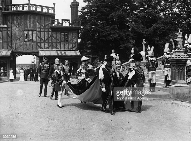 King George V of Great Britain and Queen Mary in robes of the Order of the Garter during a Royal Pageant at Windsor