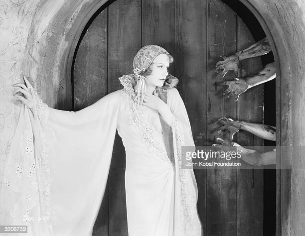 Ghoulish hands reach out for Greta Garbo in her second American film 'The Temptress'.