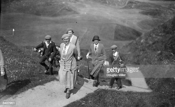 Caddies accompany Miss F J Morisch, Mrs M E Abercrombie and Mrs T W Brown on the first day of the Britannia and Eve Scottish Golf Foursomes at Cruden...