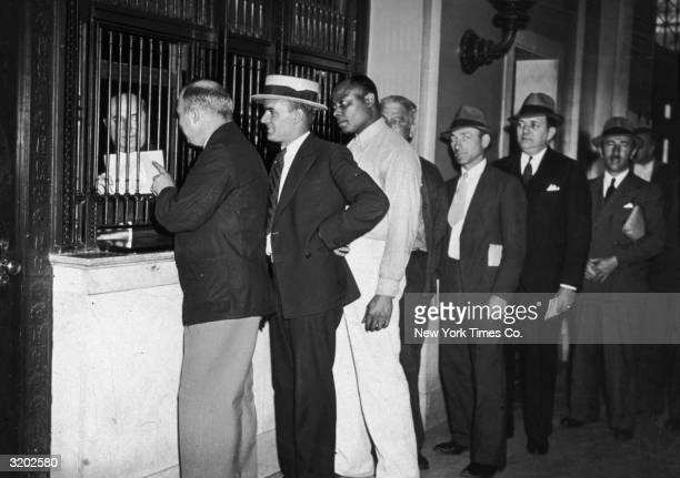 American World War I veterans wait in line to receive bonus bonds at a counter in the General Post Office New York City The government issued bonus...