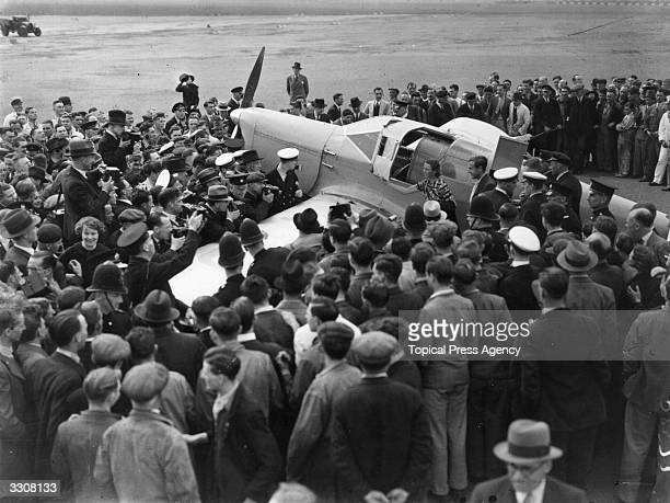 English aviator Amy Johnson arrives at Croydon after setting a new record for a solo flight from Cape Town to London