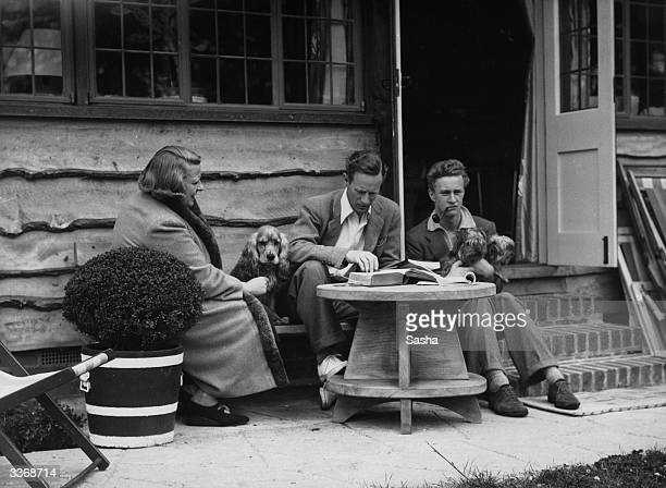 English actor Leslie Howard with his family at their home near Dorking Surrey
