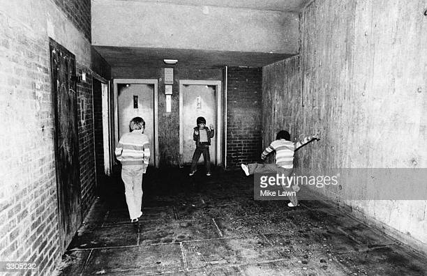Children playing football in Seaford House Bow east London