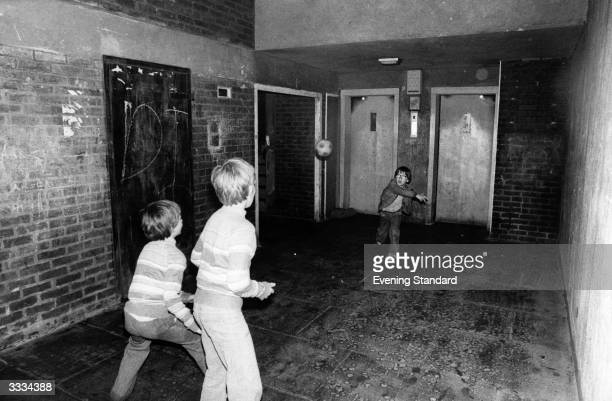 Children playing football outside the lifts in Sleaford House on the Lincoln Estate in Bow east London