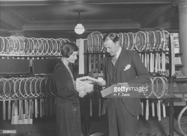 British tennis star Evelyn Colyer, who has joined the staff at Selfridges department store in London to offer advice on the choice of tennis racquets...