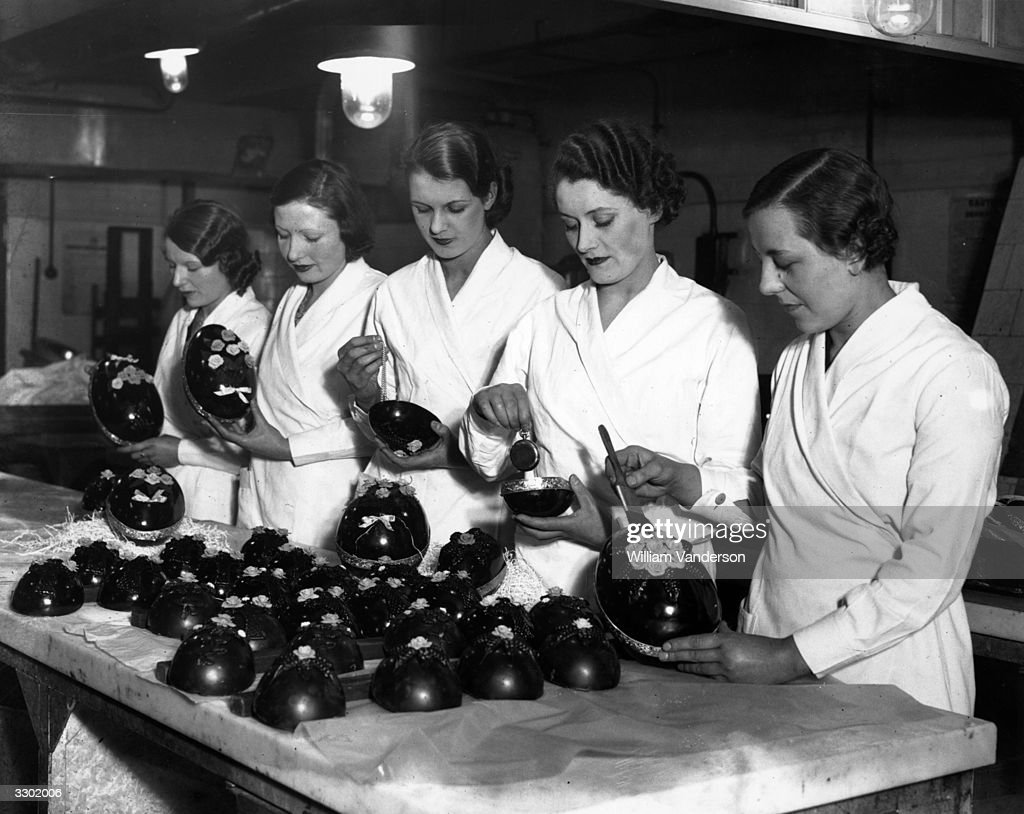 Making easter eggs pictures getty images workers filling easter eggs with customers own gifts for sale at lyons corner house negle Images