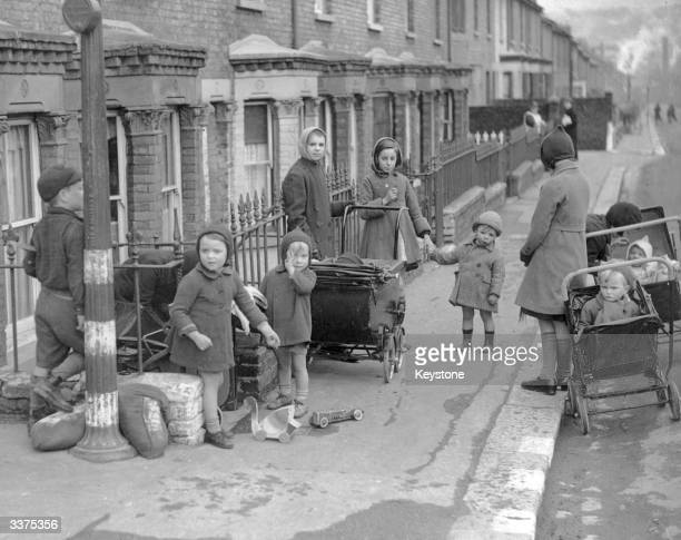 Although thousands of children have been evacuated from the town many children are still to be seen playing at 'Hellfire Corner' in Dover which has...