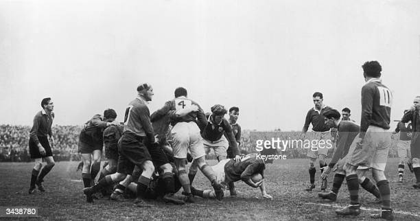 JC Daly of Ireland crawls out of a scrum with the ball during an Ireland v Wales match in Belfast Ireland won the match
