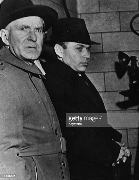 The US Deputy Marshall and Valentine Gubitchev a Soviet spy shortly after he received a suspended sentence of 15 years with deportation to Russia