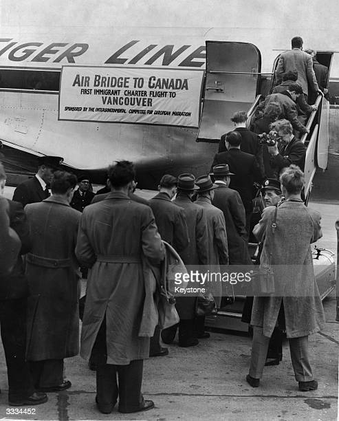 Emigrants many of them Hungarian refugees boarding the 'Air Bridge to Canada' the first immigrant charter flight to Vancouver at London Airport