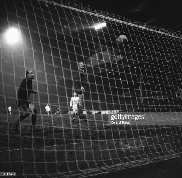 Goalkeeper Viliam Schroif and right-back Urban of Slovan Bratislava turn round in dismay as Jimmy Greaves scores a fourth goal for Tottenham Hotspur...