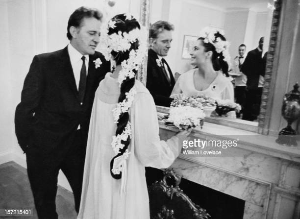 British film stars Elizabeth Taylor and Richard Burton at their first wedding in Montreal Canada They married twice but both marriages ended in...