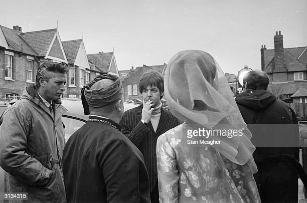 British pop group the Beatles on location in London for the filming of the musical 'Help'