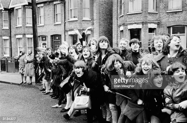 Excited young Beatles fans hoping for a glimpse of their musical heroes during the filming of the musical 'Help' on location in London