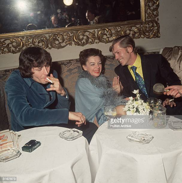After her marriage at Chelsea Registry Office London singer and film star Judy Garland celebrates with her 5th husband Mickey Deans and on the right...