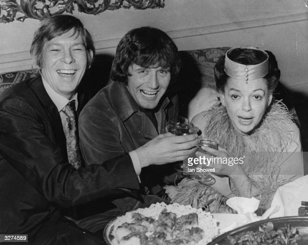Toasting bride Judy Garland are the best man singer Johnnie Ray left and the groom Mickey Deans during the wedding reception at Quaglino's London