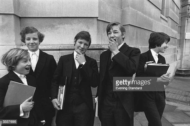 Eton College schoolboys wearing the traditional dress of the school