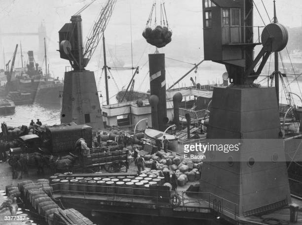 Dockers unloading ships at London Bridge three days after the end of the General Strike