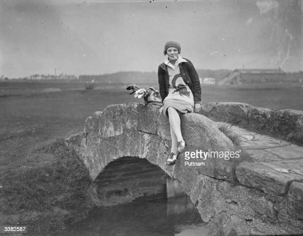 Competitor Miss Margaret Hamilton sitting on Swilcan Bridge at St Andrews golf course during the Ladies' British Open Amateur Championship The Royal...