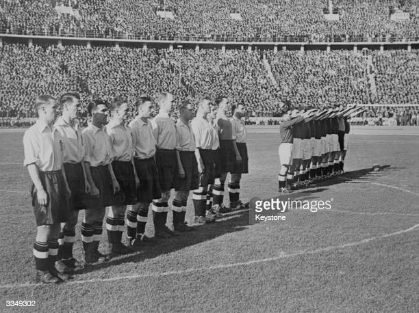 The England and German football teams before kick off in Berlin
