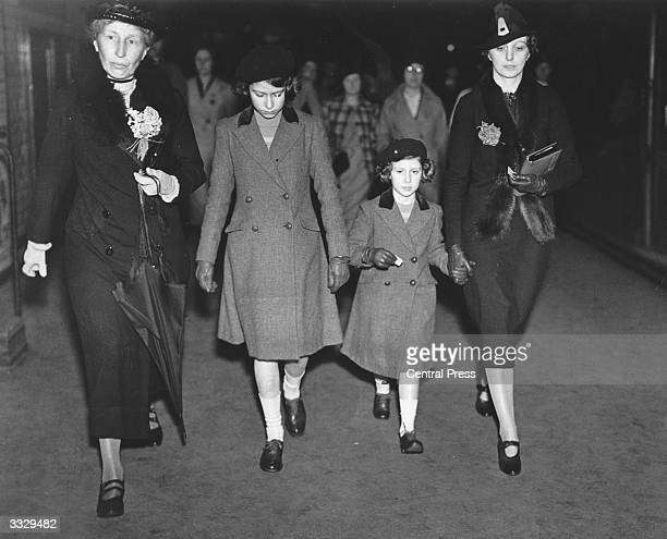 Princess Elizabeth and Princess Margaret with Lady Helen Graham and Miss Marion Crawford after their first ride on the Underground